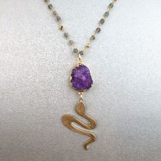 Small Gold-Covered Purple Druzy w/ Gold Textured Snake on a 30'' Laboradorite Rosary Chain. Laboradorite protects against the negativity and misfortunes of this world, and provides safe exploration into alternate levels of consciousness and in facilitating visionary experiences from the past or the future.