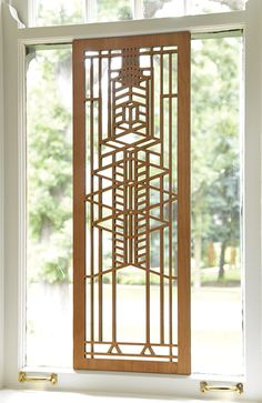 Robie Window Wood Panel; An interplay of light and dark cherry veneers adds dimension to this magnificent solid wood screen inspired by Frank Lloyd Wright's Robie House (Chicago, Illinois, 1908-10). $120.00