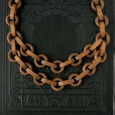 Art Deco necklace. Chunky wood chains from the 1930s  http://www.etsy.com/listing/81468191/art-deco-necklace-chunky-wood-chain