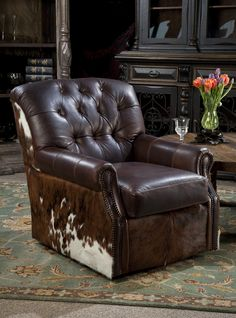 Leather swivel chair with cowhide  Brumbaugh's Fine Home Furnshings