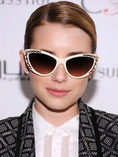 Emma Roberts wearing very cool cat-eye sunglasses