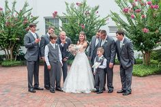 Formal portraits can sometimes feel awkward, so do something fun. This bride showed off her rock to her impressed male relatives.