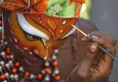 A woman gets costume make-up applied for carnival celebrations in Barranquilla, Colombia, Feb. 19.