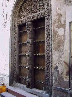 Zanzibar door with elephant protectors - Why? Because criminals used to use elephants as battering rams.