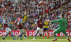 The midfielder watches his effort fly over Shay Given's bar as Arsenal saw a number of ear...