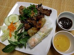 Khai Vi - Appetizer Combo. Comes with grilled beef, grilled pork, grilled chicken, spring rolls, and egg rolls.