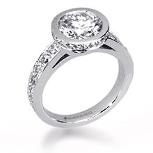 Custom Diamond Halo Bezel Engagement Ring: This customized diamond halo bezel is designed around a 1.25ct round center stone.  The architectural simplicity gives this ring a different dimension when view from different angles. All custom rings are created around the stone of your choice and priced individually.