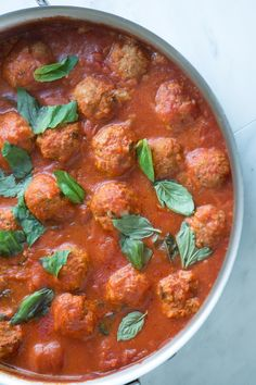 We love these meatballs. There's no lengthy cooking times, no baking and no searing the meatballs. The sauce is very simple with crushed canned tomatoes, a little tomato paste and fresh basil. The meatballs are filled with parmesan cheese, parsley and a little oregano. From inspiredtaste.net | @inspiredtaste