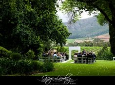 Outdoor wedding ceremony at Molenvliet Wine Farm, Stellenbosch, South Africa.