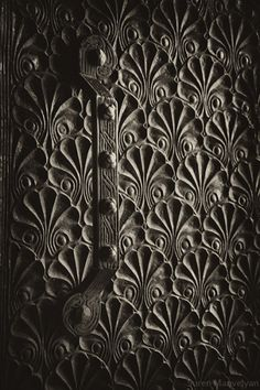 Photographs of very old Armenian doors featuring traditional Armenian symbols and a rich culture of wood carving.