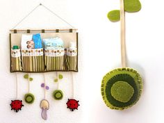 This is so whimsical and cute. Whimsical is my middle name. Well not really... but still. Hanging nursery storage by Latiendadecosecosi on Etsy, €45.00