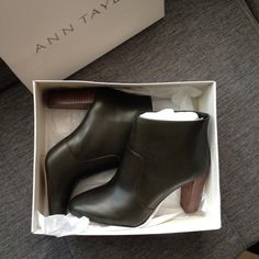 """Ann Taylor Olive Green Leather Ankle Boots Gorgeous but just didn't suit me. Dark olive in color (surprisingly goes with EVERYTHING), with wood stacked heel. Side zip makes for easy on and off. Shipped with original packaging and stuffing. Never worn! 3.5"""" heel. I tend to wear a 9 in heels and these fit well. They will probably stretch with wear due to being 100% leather. Ann Taylor Shoes Ankle Boots & Booties"""