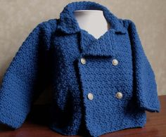 Little blue crochet baby jacket - with brass buttons, perhaps?
