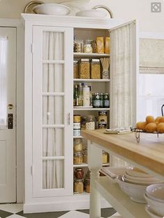 How charming is this little cottage French door pantry?!