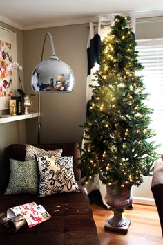 How to put your artificial Christmas tree in an urn. Adds height and room under the tree to stack packages...