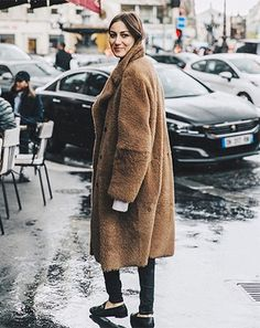 Long brown faux fur coat, skinny black jeans & black Gucci loafers on Giorgia Tordini   @styleminimalism