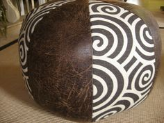 graphic and leather pouf ottoman