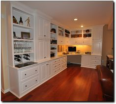 "Corner desk in built in cabinets, undercabinet lighting.  36"" min chair opening."