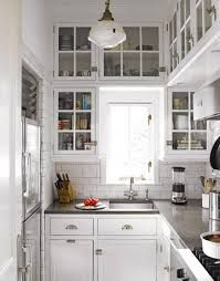 modern country kitchen - grey quartz countertops love it with the white cabinets