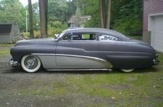 """1949 Mercury Coupe - complete with louvers, '56 Olds """"spinners"""" and """"lakes pipes"""" Period right for sure!"""