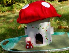 How sweet is this little mushroom house made from recyclables??