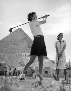 An English tourist drives off at the new Mena House Golf Course, situated almost at the foot of the Great Pyramid at Giza, near Cairo, Egypt, 1938.