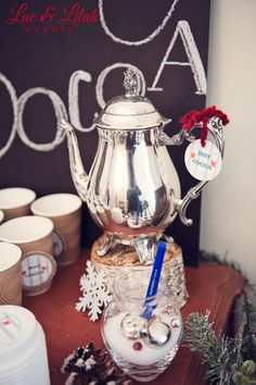 I love using a fancy tea pot to serve hot cocoa at a Christmas party! See more party ideas at CatchMyParty.com.