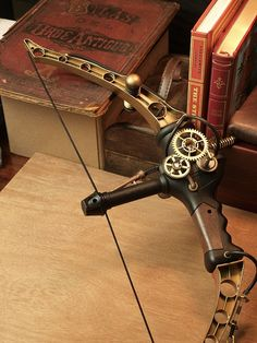 I WANT THIS Steampunk bow. This is really cool and would look great in a steampunk Hawkeye cosplay thing.