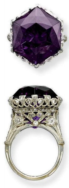 A BELLE EPOQUE AMETHYST AND DIAMOND RING.  Set with an hexagonal amethyst to the openwork millegrain diamond-set gallery and half-hoop, circa 1915, ring size 7, with French assay marks for platinum and gold  Christie's.