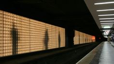 ACTIVE - Jason Bruges - Platform 5. A virtual platform filled with passengers' shadows within a glass block wall. Ghostly but poetic.