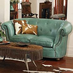 Turquoise tufted leather loveseat