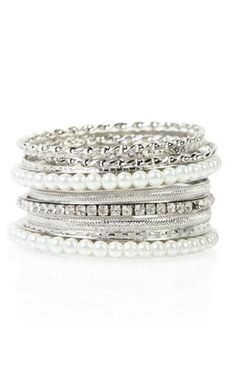 white bangles set with stones and pearls