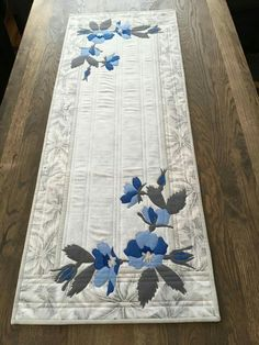 Lovely Blue Appliqued Flowers adorn this Pretty Table runner.