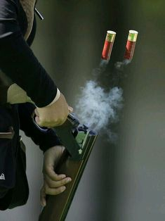 South Korea's Lee Bo-na ejects empty cartridges during the women's double trap shooting competition at the Asian Games at Gyeonggido Shooting Range in Incheon, South Korea, Thursday, Sept.