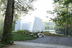 An Abstract New England Lake House That Sinks Into the Land   Dwell