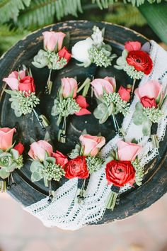 coral and pink ranunculus and rose boutonnieres  Photography: Sargeant Creative - www.sargeantcreative.com/  Read More: http://www.stylemepretty.com/2014/06/02/rustic-california-celebration-layered-with-pink/