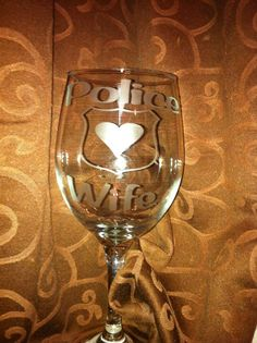 Police Wife Wine glass I made using etch cream and vinyl.