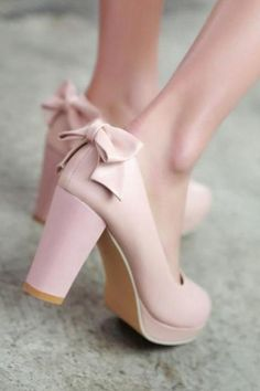 Pink bow back round toe pump
