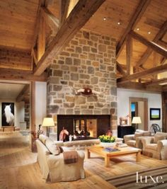 Living room with stone fireplace | Living Rooms | LUXE Source
