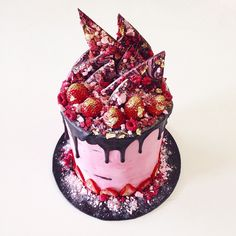 Katherine Sabbath. Layers of chocolate brownie filled with raspberry Swiss meringue buttercream, toasted coconut flakes, crushed meringue & freeze-dried raspberries