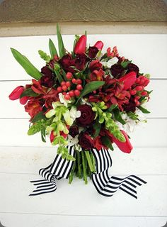 Magnificent red and green #bouquet with crisp black and white striped ribbon  - blossom sweet
