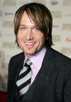 Keith Urban...because the one thing better than a man in leather is a man in a suit.