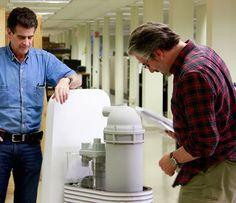 Dean Kamen and Paul Lazarus inspect Kamen's SlingShot water filter...