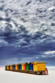 Love the contrast between the stormy sky and the bright colors of the cabanas