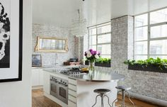 Kitchen exposed brick white washed stainless steel counters countertops white cabinets cabinetry White Cabinets White Countertops, White Kitchen Cabinets, Kitchen White, Kitchen Island, White Kitchens, Stainless Countertops, Island Table, Kitchen Windows, Gold Kitchen