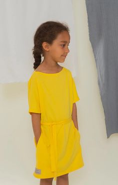 Boat neck tunic dress in sunshine yellow. We donate all the profits of this product to the Baltic Sea Action Group. Sailor Dress, Leftover Fabric, Sustainable Clothing, Timeless Design, Knitwear, Classic T Shirts, Sunshine, Yellow, Kids