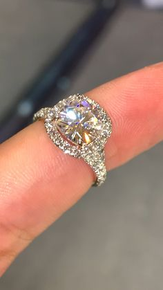 So Beautiful and sparkly Diamond Halo cushion cut in white gold 18 k engagement ring. SLVH ♥♥♥ rings cushion Cushion Moissanite Engagement Ring in Split Shank Diamond Halo Setting on White Gold Engagement Ring Rose Gold, Dream Engagement Rings, Cushion Halo Engagement Rings, Moissanite Engagement Rings, Cushion Cut Halo Ring, Expensive Engagement Rings, Wedding Ring Cushion, Oval Engagement, Cushion Cut Diamonds