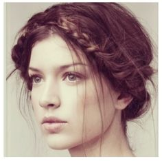 Braided crown that could be neat for wedding hair with flowers intertwined