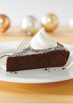 Chocolate Truffle Pie – There is nothing like the rich, dense filling of a truffle when you're in the mood for chocolate... and you'll enjoy that fantastic flavor translated into this creamy pie.