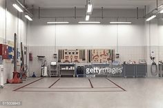 Stock Photo : Auto Repair Shop Interior with Mechanic in Background Led Garage Lights, Led Shop Lights, Garage Lighting, Shop Lighting, Kitchen Lighting, Lighting Ideas, Car Repair Service, Auto Service, Service Ideas